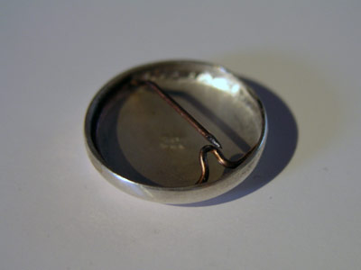 1 inch solid silver badge backside